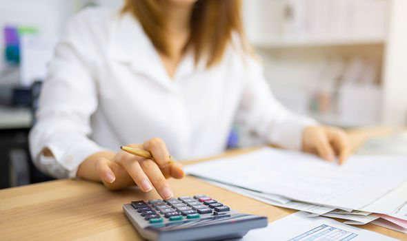 a woman sitting at a desk: Capital gains tax news: