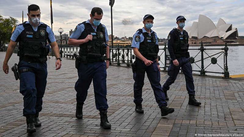 a group of people on a sidewalk: Authorities in Sydney have extended the lockdown until the end of September due to a spike in infections