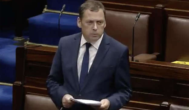 a man wearing a suit and tie: The former minister also clarified, regarding his own situation: 'I didn't resign, by the way, I was sacked by the Taoiseach.' Pic: RollingNews.ie / Dail Eireann live