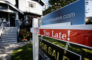 a sign on the side of a building: Detached home buyers continue to face the largest price increases in Vancouver (REUTERS/Ben Nelms)