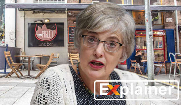 Katherine Zappone sitting at a table in front of a building