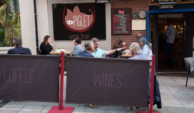 a person standing in front of a store: Leading food writer Tom Doorly was full of praise for its selections of wines and proclaimed that the bar was 'right up there with the best of them'. Pic: Fran Veale