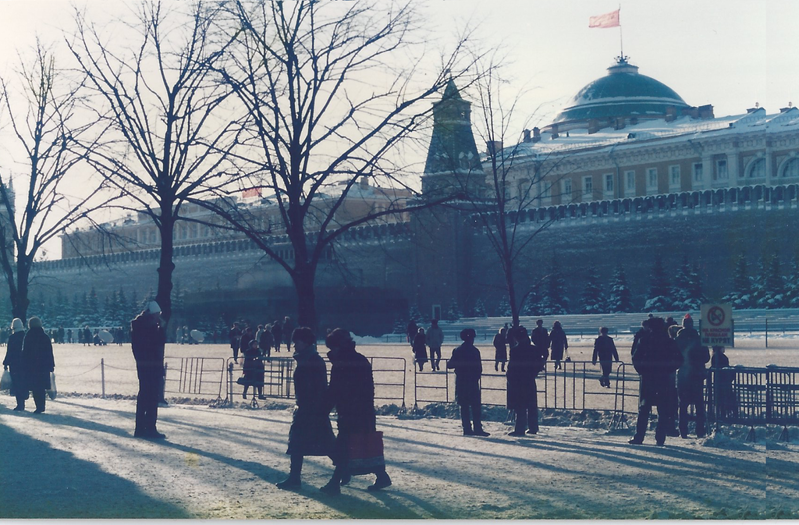 a group of people walking down the street: Back to the future: Russia may move to a simpler Soviet model for issuing visas, as prevailed in Red Square in 1986 (pictured) - Simon Calder