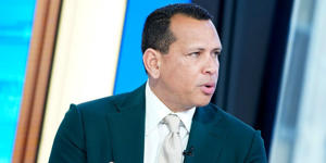 Alex Rodriguez wearing a suit and tie: John Lamparski/Getty Images