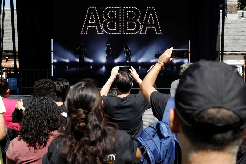 Fans react to the music during the ABBA Voyage event