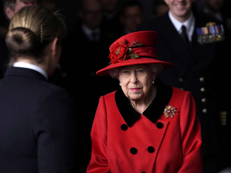 a man wearing a hat: Britain's Queen Elizabeth visits Royal Navy aircraft carrier HMS Queen Elizabeth at HM Naval Base in Portsmouth, Britain May 22, 2021. Steve Parsons/PA Wire/Pool via REUTERS