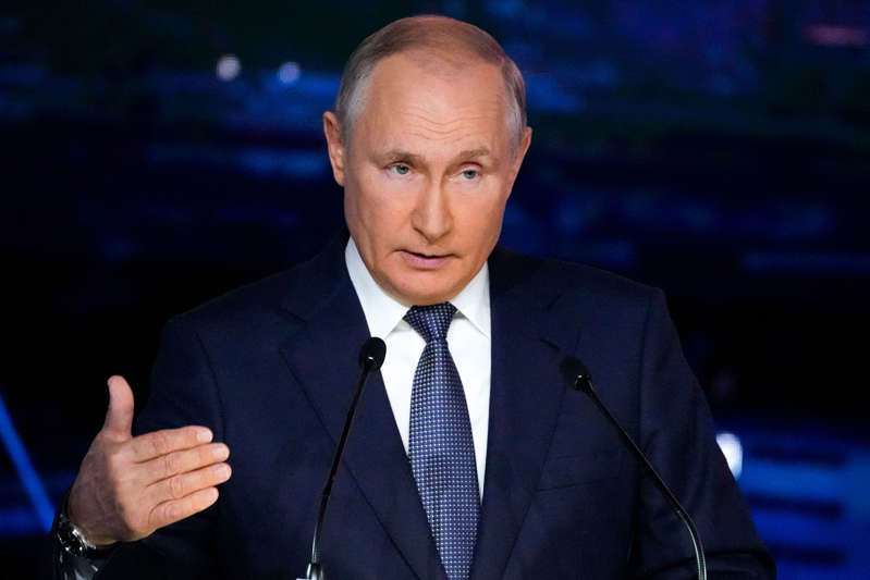 Vladimir Putin wearing a suit and tie: Putin Says the Sooner Taliban Join 'Civilized' States the Better