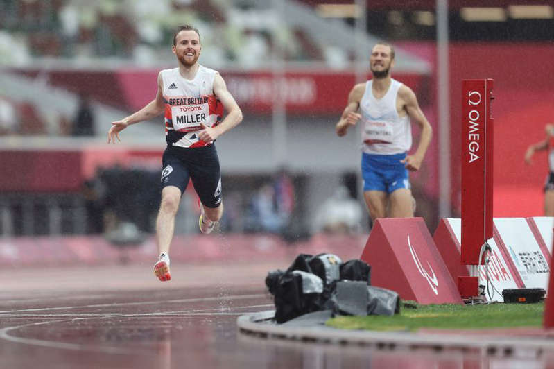 a person jumping in the air: Great Britain's Owen Miller also won gold in the 1500m T20
