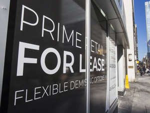 a sign on the side of a building: The demand for office and retail space has waned during the pandemic.