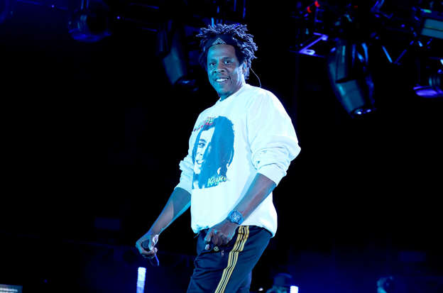 JAY-Z standing on a stage