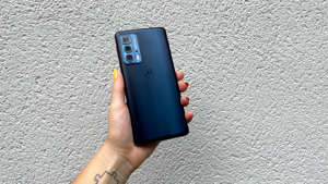 a hand holding a cellphone: Motorola Edge 20 Pro review