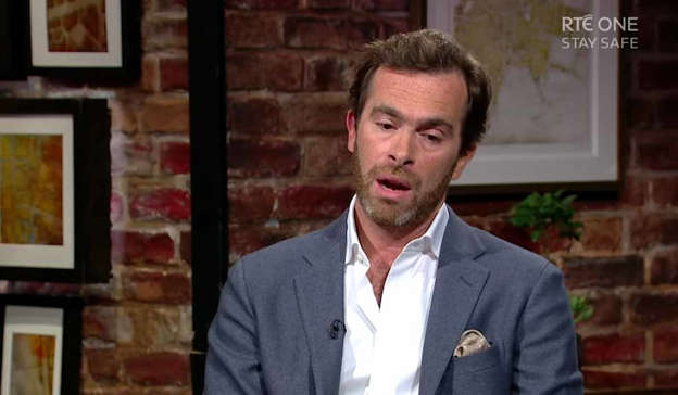 Pierre-Louis Baudey-Vignaud in a suit standing in front of a brick building: Pierre Baudey-Vignaud made a direct appeal to people across Ireland to come forward with any information about his mum's death. Pic: RTÉ