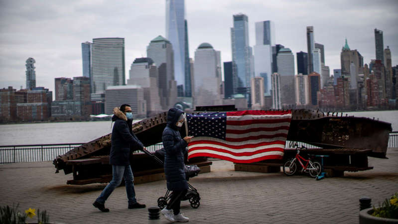 a man sitting on a bench in the city: The Department of Homeland Security has warned of terror attacks as they 20th anniversary of 9/11 approaches