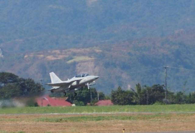 a plane flying over a field: PAF's FA-50 jet
