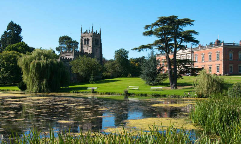 a pond in front of a building: 'A great base for adventures in the National Forest': Ashby de la Zouch, Leicestershire. Photograph: Tracey Whitefoot/Alamy
