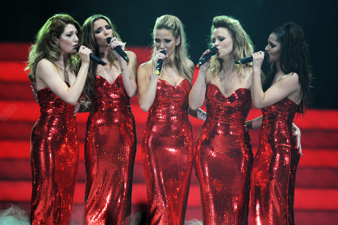 Nicola Roberts, Nadine Coyle, Sarah Harding standing around each other: Girls Aloud perform on stage on the first night of their