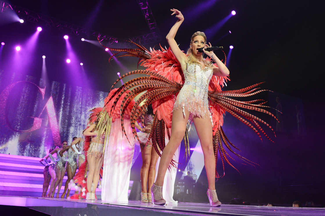 Sarah Harding standing on a stage: Sarah Harding of Girls Aloud performs on their 'Ten - The Hits Tour' at The O2 Arena on March 1, 2013 in London, England. (Dave J Hogan / Getty Images)