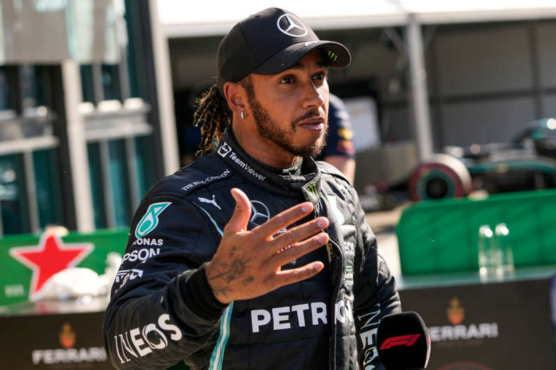 a man standing in front of a crowd: Lewis Hamilton felt mistakes had been made by his team (Francisco Seco/AP) - AP