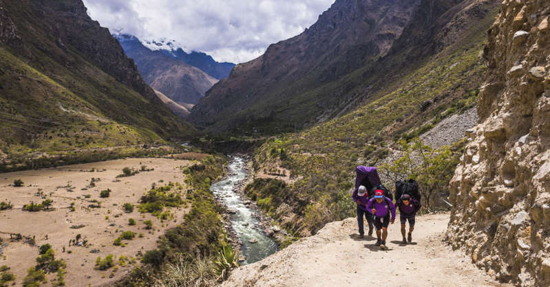 a man riding a horse on the side of a mountain trail: Like visitors to Machu Picchu, the number of hikers on the Inca Trail have also been restricted.