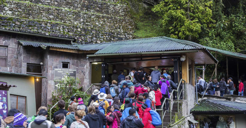 a group of people standing in front of a crowd: Machu Picchu was built to accommodate some 400 residents with some 1,200 additional people during festivals, according to archaeologist Jose Miguel Bastante.