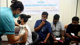 a group of people looking at each other: A record number of 1,225,541 doses of Covid vaccines were administered to residents inMaharashtra on Saturday. (HT Photo)