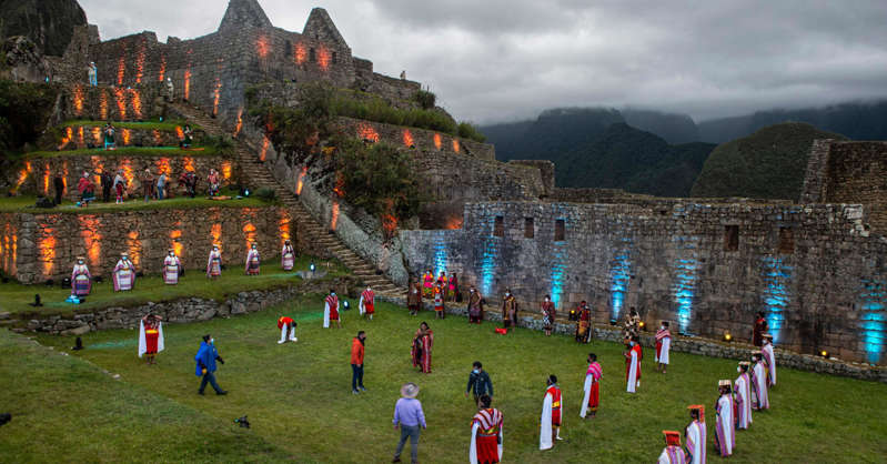 a group of people on a field: Machu Picchu is one of only eight mixed UNESCO World Heritage sites in Latin America and the Caribbean, which means it holds both cultural and natural importance.