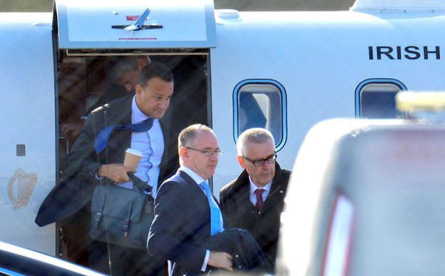 a group of people standing in front of a car: Stock photo of Leo Varadkar arriving at Liverpool Airport in October 2019.