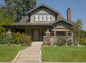 a large lawn in front of a house: Can iBuyers Win in a Hot Real Estate Market?