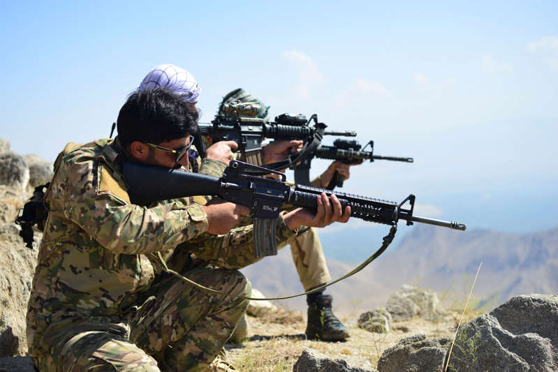 FIle: Afghan resistance movement and anti-Taliban uprising forces take positions as they patrol on a hilltop in Darband area in Anaba district, Panjshir province on September 1, 2021.  (Photo by AHMAD SAHEL ARMAN/AFP via Getty Images)