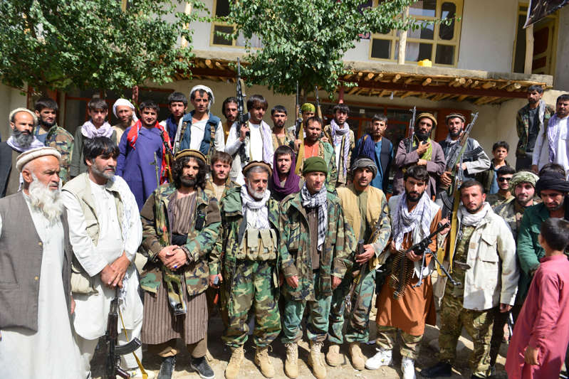 File: Afghan resistance movement and anti-Taliban uprising forces gather in Khenj District in Panjshir province on August 31, 2021.  (Photo by AHMAD SAHEL ARMAN/AFP via Getty Images)