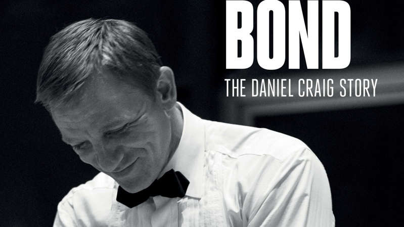 a man wearing glasses: Daniel Craig shares his memories of 15 years as 007 in the Being James Bond documentary. Pic: Apple TV