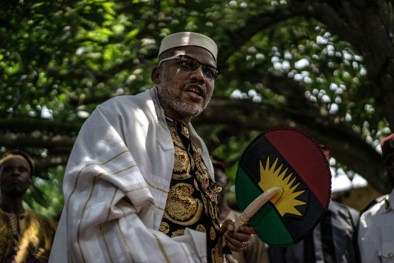 FILE - Political activist and leader of the Indigenous People of Biafra (IPOB) movement, Nnamdi Kanu, wears a Jewish prayer shawl as he walks in his garden at his house in Umuahia, southeast Nigeria, on May 26, 2017.