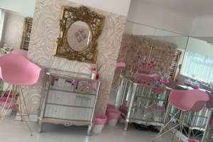 a dining room table: Inside Lois Jane Hair & Beauty on Longview Drive in Huyton