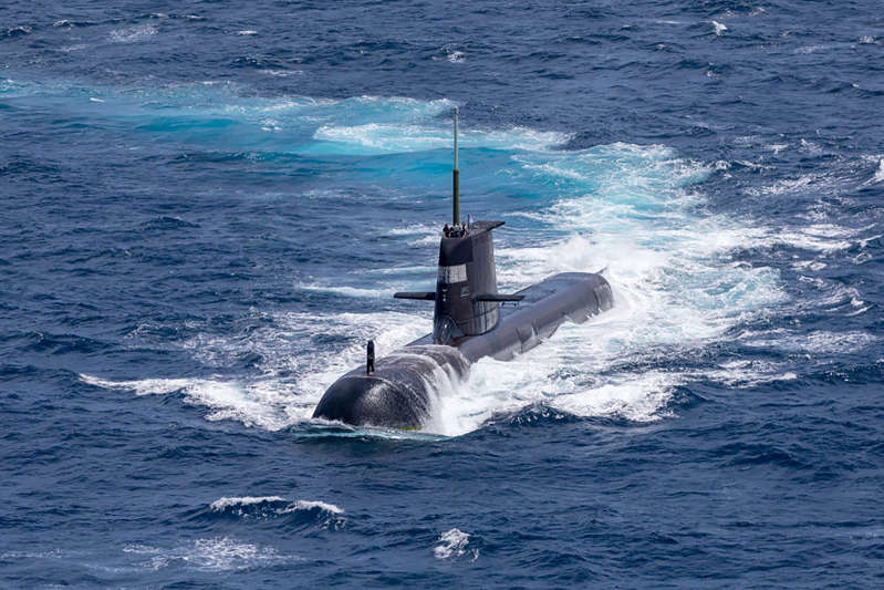 a large ship in a body of water: Royal Australian Navy submarine HMAS Rankin is seen during a biennial maritime exercise between the Royal Australian Navy and the Indian Navy on Sept. 5, 2021 in Darwin, Australia.
