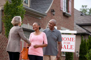 Pops Staples standing in front of a building: 3 Growth Stocks Transforming the Real Estate Business