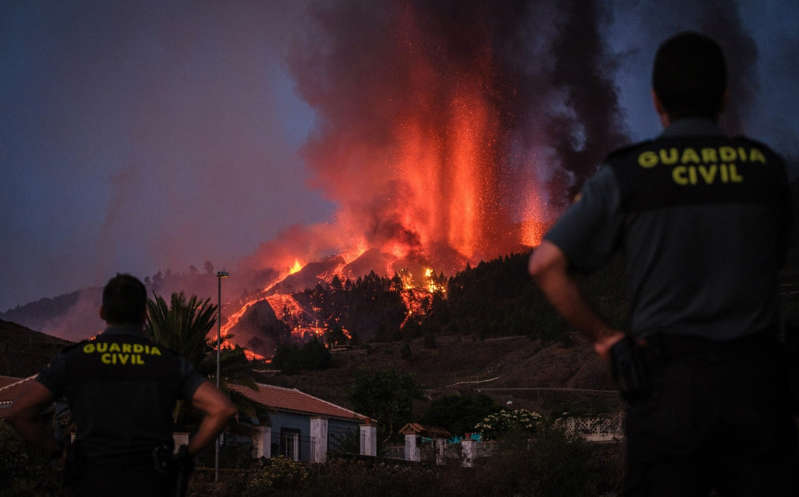 a man standing in front of a fire: The Cumbre Vieja volcano erupted on Spain's Canary Islands today - Andres Gutierrez/Anadolu