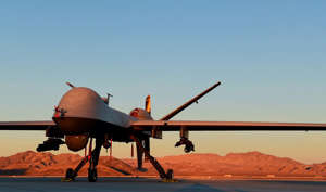 a large air plane on a runway: An MQ-9 Reaper sits on the flight line at Creech Air Force Base, Nevada, on Dec. 17, 2019.
