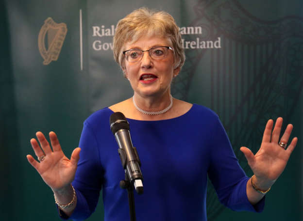 Katherine Zappone standing in front of a stage