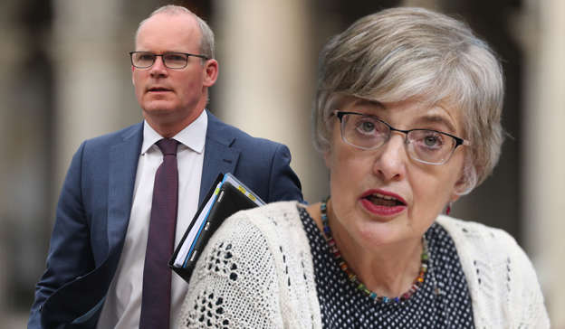Simon Coveney, Katherine Zappone wearing a suit and tie