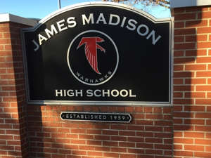 a sign in front of a brick building: Vienna area public and private high schools are ranked among the top in the state, according to Niche's 2022 rankings.