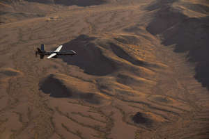 a bird flying over the top of a mountain: An MQ-9 Reaper flies a training mission over the Nevada Test and Training Range, July 15, 2019.