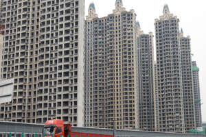 a tall building in a city: Fear of China's Evergrande Real Estate Contagion Spreading to Global Commodity Markets Looms Large