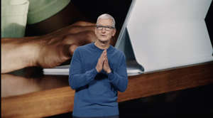 Tim Cook standing in front of a laptop: Apple CEO Tim Cook. Apple