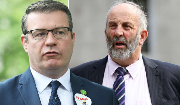 Alan Kelly wearing a suit and tie