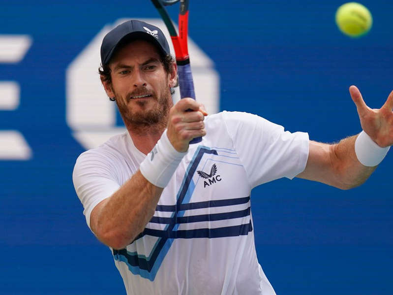 a baseball player swinging a racket at a ball: Andy Murray marched on to the next round in Metz (AP Photo/Seth Wenig)