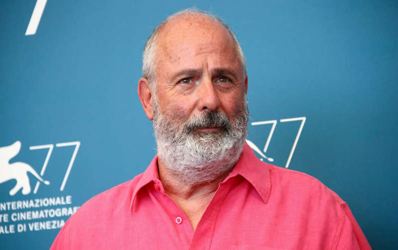 Roger Michell wearing a blue shirt: Roger Michell poses for photographers at the photo call for the film 'The Duke' during the 77th edition of the Venice Film Festival in Venice, Italy, on Sept. 4 - Joel C Ryan/Invision
