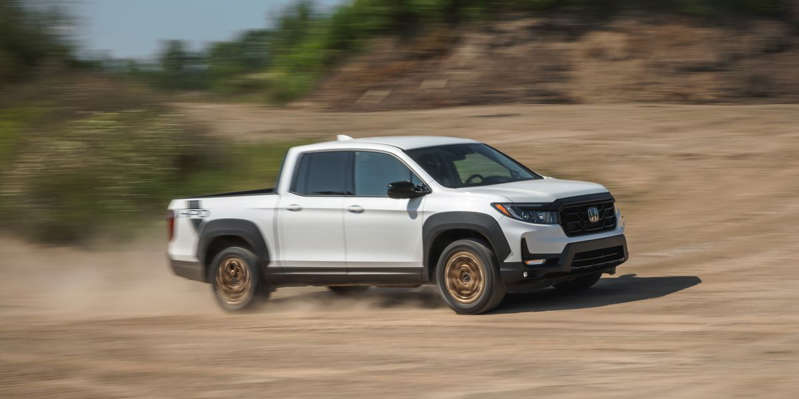 Revised styling and a new Honda Performance Development package aim to help Honda's pickup look more like a conventional truck, with mixed results.