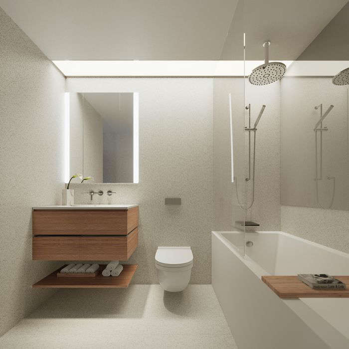 a room with a sink and a mirror:  Large format terrazzo tiles on the floor and walls in the bathroom.