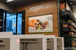 a store front at day: Scanners at the entrance of an Amazon Go store in Seattle. (GeekWire File Photo)