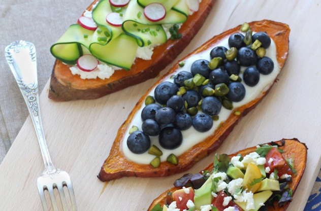 Slide 1 of 9: For the base:  2 sweet potatoes Olive oil Fine sea salt Freshly cracked black pepper  For the goat cheese, zucchini radish toast:  1/2 cup goat cheese 1 zucchini 6 radishes 6 sprigs of chives  For the tomato-avocado toast:  1 avocado 8 cherry tomatoes 1 large handful of mixed salad greens 1 small piece of feta 2-6 stalks of cilantro  For the sweet blueberry toast:  1 plain yogurt 1 1/3 cup blueberries 1 handful of pistachios